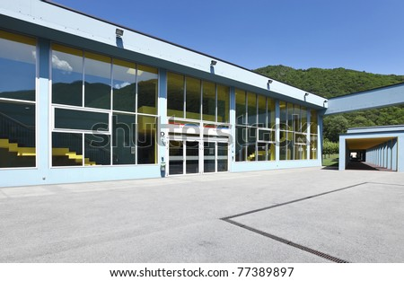 public school, building from the outside, entry gym - stock photo