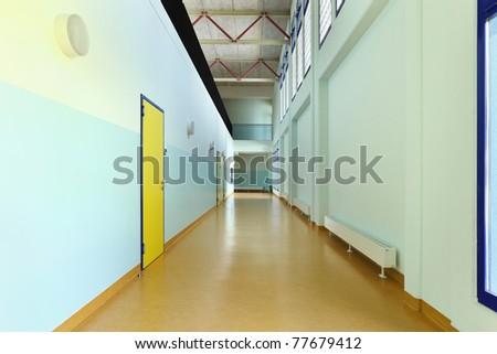 public school, long corridor with yellow door
