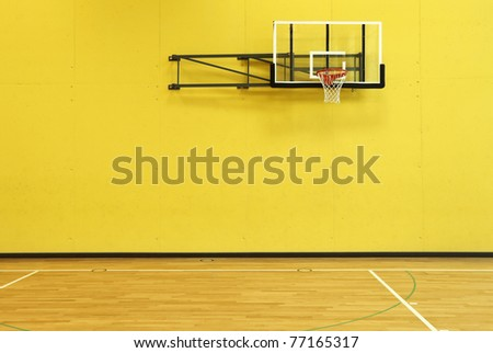 public school, yellow wall and basket, interior - stock photo