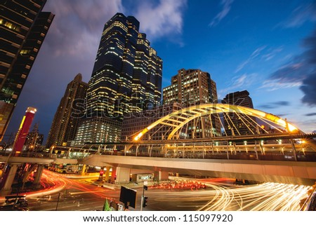 public skywalk at bangkok downtown square night in business zone