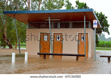 Public toilets and bathrooms flooded after heavy rain and flooding in Queensland, Australia