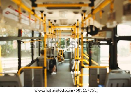 Public transportation. Blur image of interior of modern city bus