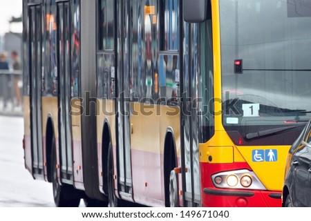 Public transportation, yellow bus background