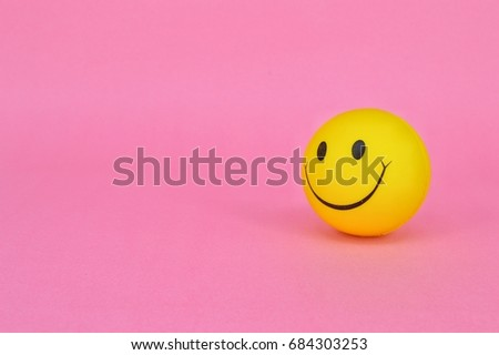PUCHONG, SELANGOR, 25 JULY, 2017: Image of a yellow ball with Smiley face (smiley).On pink background. #684303253