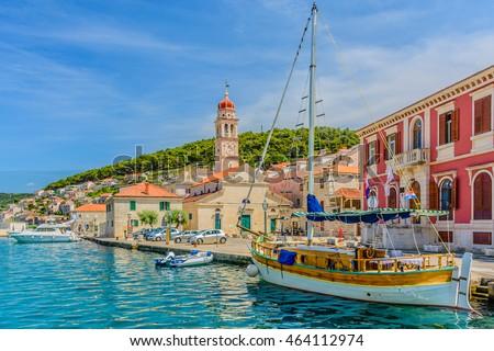 Pucisca is small town on Island of Brac, popular touristic destination on Adriatic sea, Croatia. / Pucisca town Island of Brac. / Selective focus.