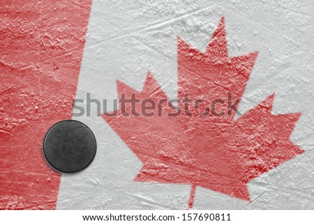 Puck and a Canadian flag image on the hockey rink