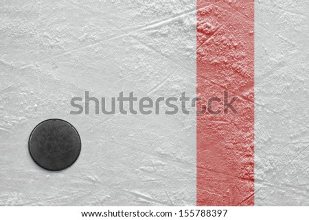 Puck lying on a hockey rink. Texture, background