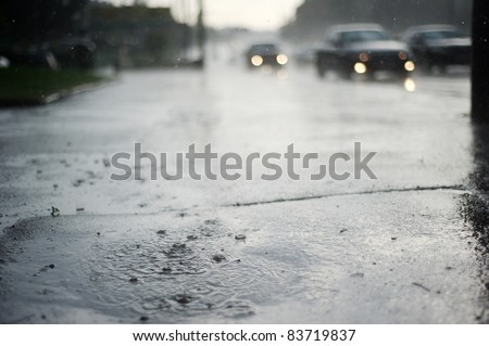 Puddle near the wet road in the rain