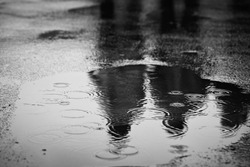 Puddle of water in rain - selective focus