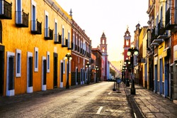 Puebla de Zaragoza, Mexico. Morning streets in the one of the five most important Spanish colonial cities in the country. Famous history and architectural styles at susnrise