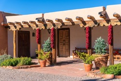 Pueblo style adobe architecture home  with ristras in Santa Fe, New Mexico