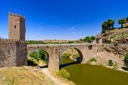 Puente de Alcántara, a Roman arch bridge across the Tagus River in Toledo, Spain
