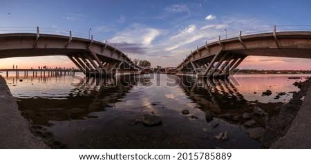 Puente de la Barra during colorful sunset, Maldonado, Uruguay Foto stock ©