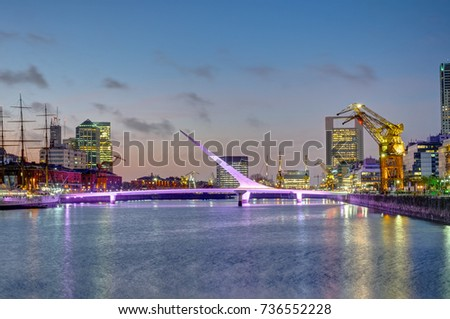 Shutterstock Puerto Madero and the Puente de la mujer in Buenos Aires, Argentina, at sunset