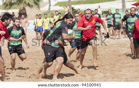 "PUERTO REAL, CADIZ - OCTOBER 17: Play Attack of ""Watermelons"", green, Against the team of ""Gibraltar Rugby"" gray. in the tournament ""Villa Puerto Real."" October 17, 2011 in Puerto Real, Cádiz (Spain)"