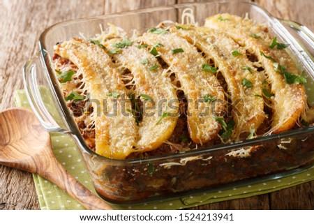 Puerto Rican food casserole Pastelon de Platano Maduro close-up in a baking dish on the table. horizontal Foto stock ©