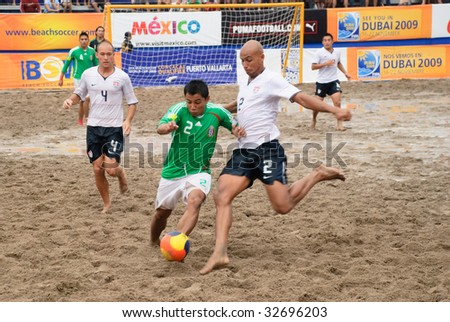 PUERTO VALLARTA - JUNE 21: Mexico Victor Lopez battes with USA Giovanni Garcia during the Concacaf beach soccer FIFA world cup qualifier 3rd 4th match on June 21 2009, in Puerto Vallarta, Mexico