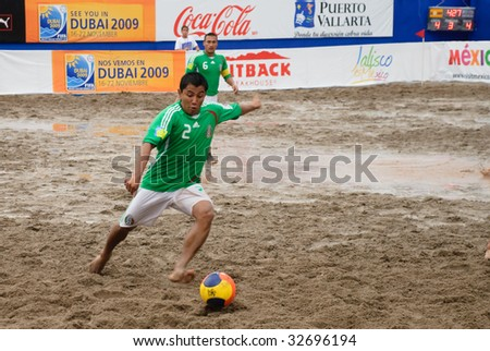 PUERTO VALLARTA - JUNE 21: Mexico Victor Lopez shoots againt USA during the Concacaf beach soccer FIFA world cup qualifier 3rd 4th match on June 21 2009, in Puerto Vallarta, Mexico