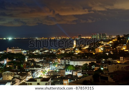 Puerto Vallarta, Mexico from bird view at night. Puerto Vallarta is a Mexican balneario resort city situated on the Pacific Ocean's Banderas Bay.
