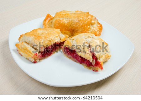 puff ham with cranberry and apple on plate