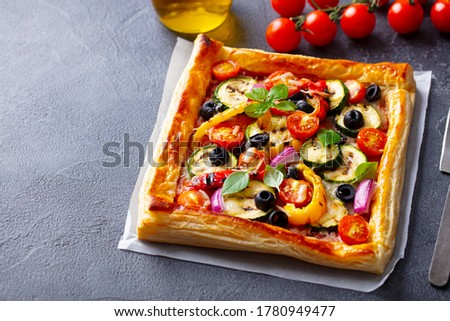Puff pastry pizza with grilled vegetables. Grey background. Close up. ストックフォト ©