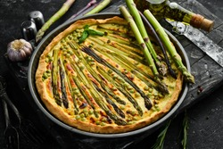 Puff pastry tart with asparagus and spices. Healthy food. Top view. Free space for your text.