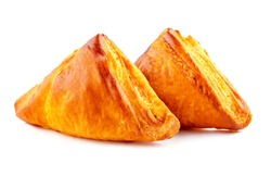 Puff pastry triangles with cheese isolated on white background.