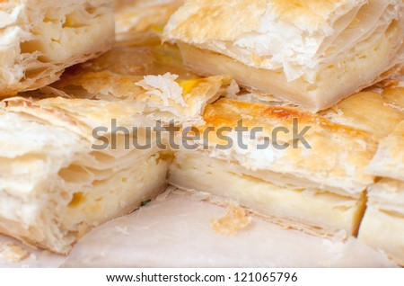 Puff pastry with cheese closeup - stock photo