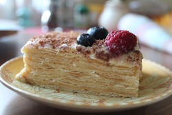 Puff pastry with cream, chocolate chips, raspberries and blueberries