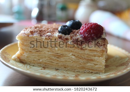 Puff pastry with cream, chocolate chips, raspberries and blueberries ストックフォト ©