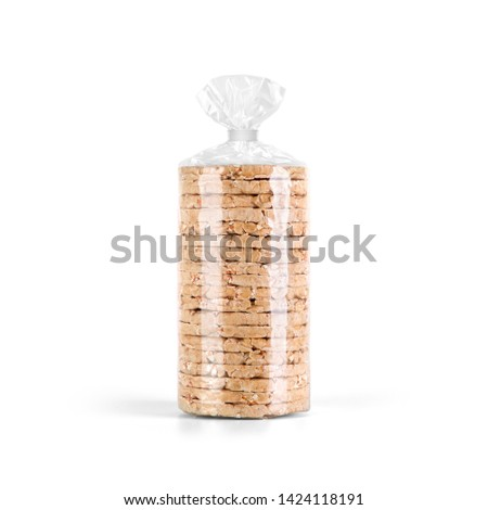 Puffed whole grain Crispbread stack in transparent plastic bag isolated on white background. Packaging template mockup collection. Stand-up Front view package. #1424118191
