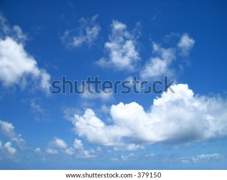 Puffy clouds drifting in on a sunny day on the Windward side of Oahu, Hawaii