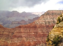 Puffy white clouds in the Grand canyon valley, fantastic view, canyon background