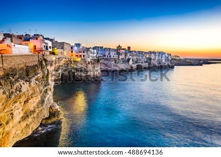 stock photo puglia italy sunset scenery of polignano a mare town in the province of bari apulia southern 488694136 - Каталог — Фотообои «Море, пляж»