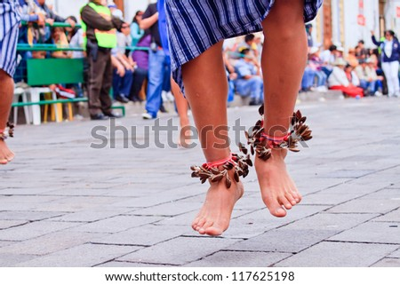 PUJILI, ECUADOR - 25 JUNE :feet of indigenous man dancing in traditional costume, Inti Raymi festivities, 25 June 2011 PUJILI, ECUADOR