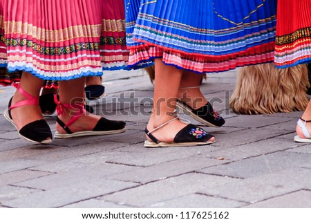 "PUJILI, ECUADOR - 25 JUNE : feet of indigenous women in ""alpargatas"" shoes in traditional costume, Inti Raymi festivities, 25 June 2011 PUJILI, ECUADOR"