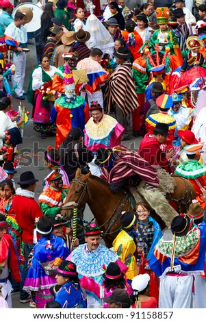 PUJILI,ECUADOR - 25 JUNE : group of men dressed in traditional colorful costumes on the streets of Pujili , Inti Raymi festival celebrated on 25 June 2011
