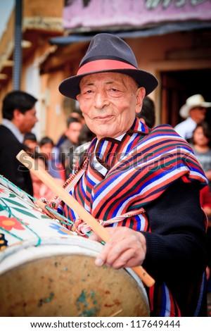 PUJILI, ECUADOR - 25 JUNE : indigenous elder in traditional costume, Inti Raymi festivities, 25 June 2011 PUJILI, ECUADOR