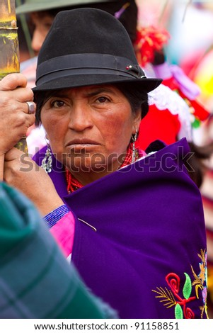 PUJILI,ECUADOR - 25 JUNE : peasant dressed up in traditional costume waits for the beginning of Inti Raymi festival celebrated on 25 June 2011 - stock photo
