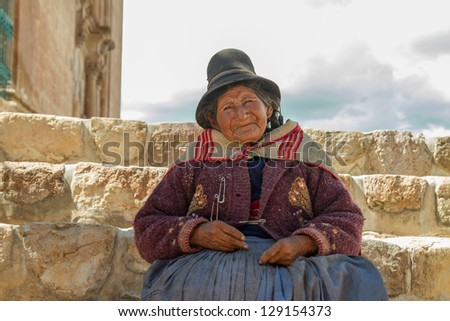 PUKARA PERU -JANUARY 15: Quechua indian woman welcomes tourists in Pukara, Peru on January 15, 2013. Pukara is a popular destination for tourism in Peru.