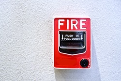 Pull station or call point, Manual fire alarm activation, Activated Notifier pull station,  Modern fire alarm pull stations, Single action to pull down the handle to sound.