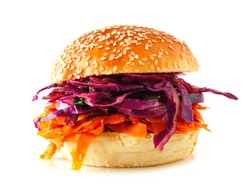 Pulled carrot meatless burger with red cabbage slaw isolated on a white background. Healthy eating, plant-based meat substitute concept.