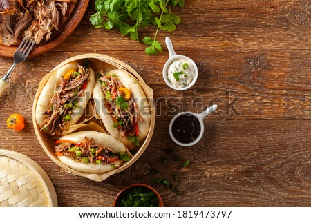 Pulled pork in a Bao Bao roll. Top view. Stock photo ©