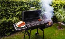 Pulled Pork of a pork shoulder roasted on a smoker