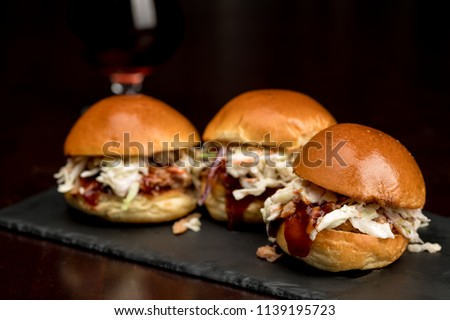 Pulled pork sliders on a surving platter ready to eat