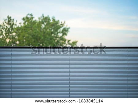 Pulled up Pleated Shades on window #1083845114