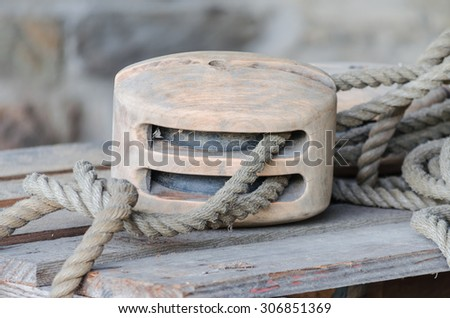 Pulley of an old wooden sailboat #306851369