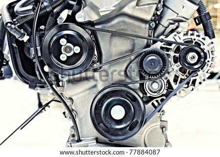 pulleys with belt in the car motor