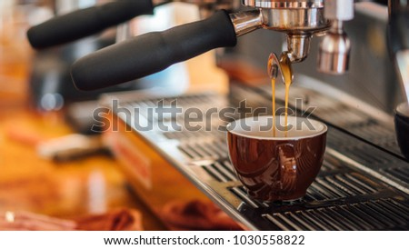 Pulling a shot of espresso coffee #1030558822