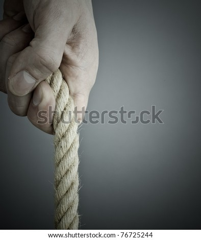pulling the rope. Grey background